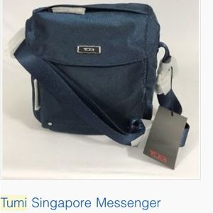 Tumi Singapore Messenger bag. Never worn or used.